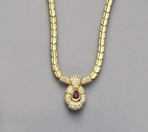 A RUBY, DIAMOND AND 18K GOLD NECKLACE