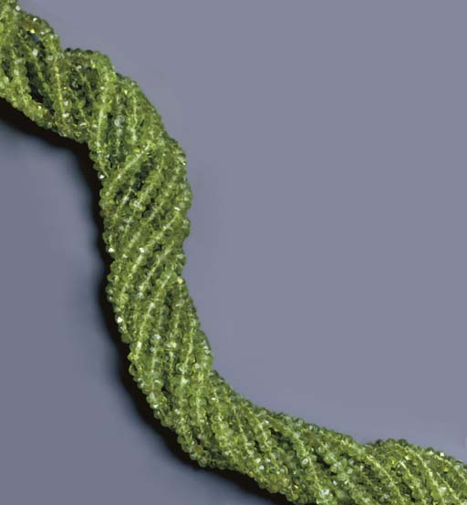 A MULTI-STRAND PERIDOT, DIAMON
