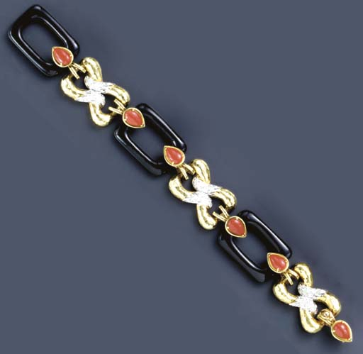 **AN ONYX, CORAL, DIAMOND AND