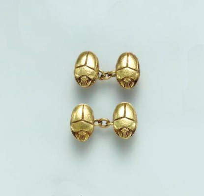 TWO PAIRS OF GOLD AND RUBY CUF