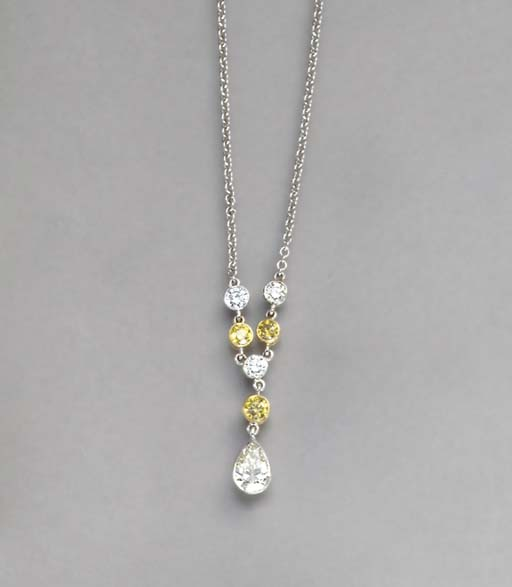 A DIAMOND, COLORED DIAMOND AND 18K WHITE GOLD NECKLACE
