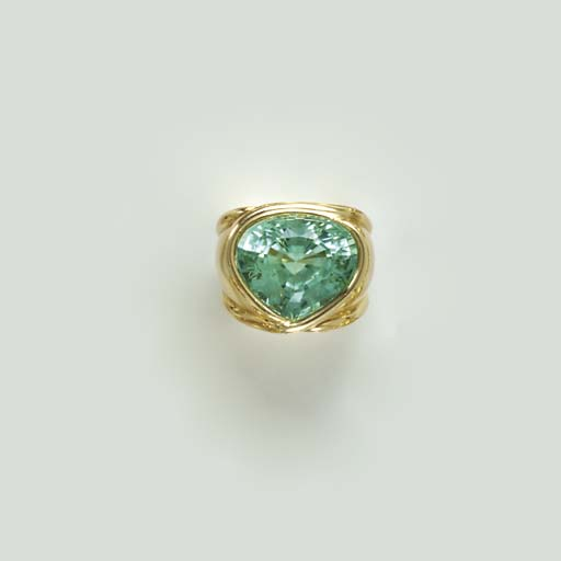 A TOPAZ AND 18K GOLD RING, BY