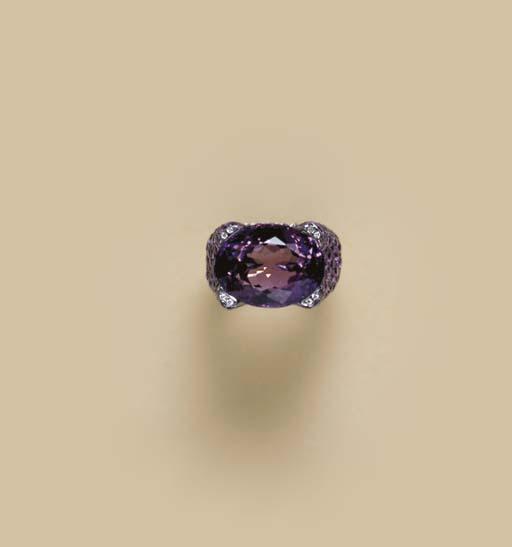 AN AMETHYST, DIAMOND AND OXIDI