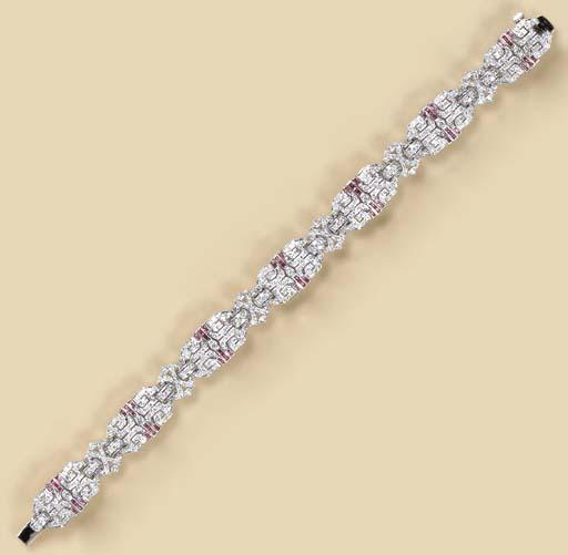 A DIAMOND, RUBY AND 18K WHITE
