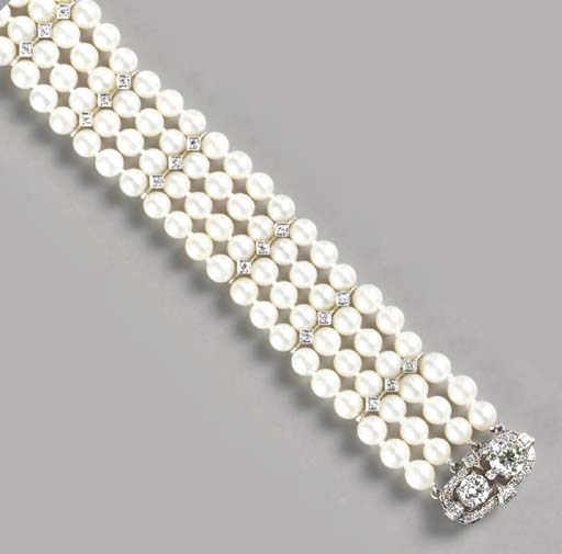 A FOUR STRAND CULTURED PEARL, DIAMOND AND 14K WHITE GOLD BRACELET