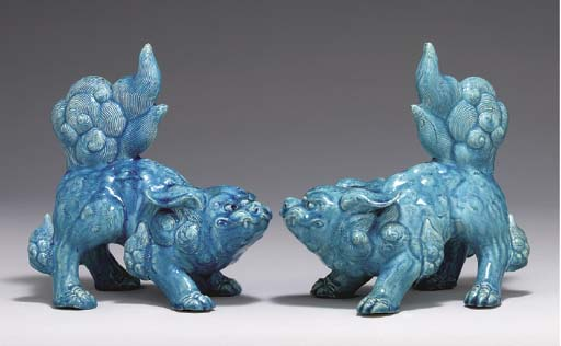 A PAIR OF STONEWARE MODELS OF
