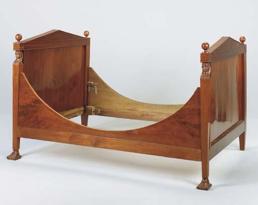 AN EMPIRE MAHOGANY BED,