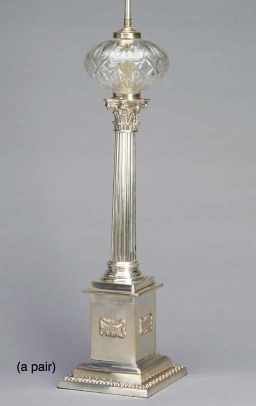 A PAIR OF SILVERED METAL COLUM