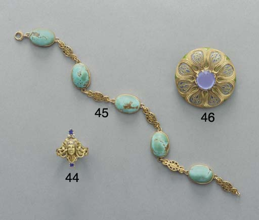 A CABOCHON TURQUOISE AND GOLD