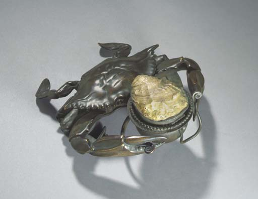 A BRONZE, SEA SHELL AND GOLD F
