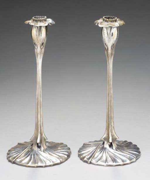 A PAIR OF SILVERED BRONZE CAND