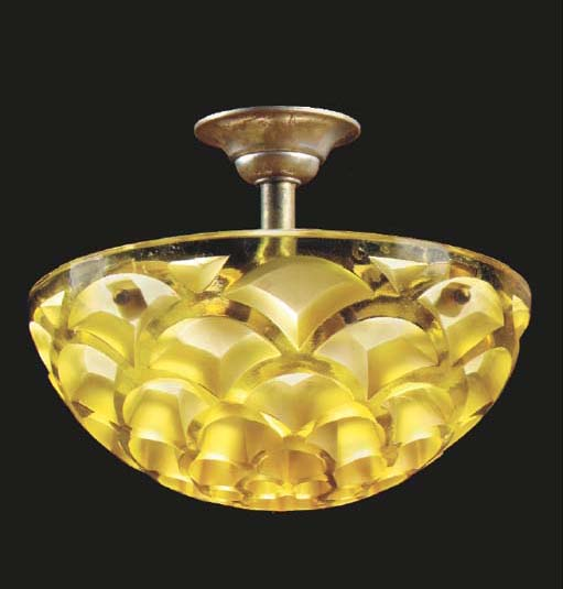 'RINCEAUX', AN AMBER GLASS PLA