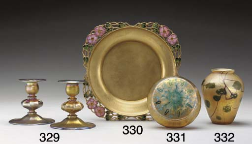 AN ENAMELED GILT-METAL CHARGER