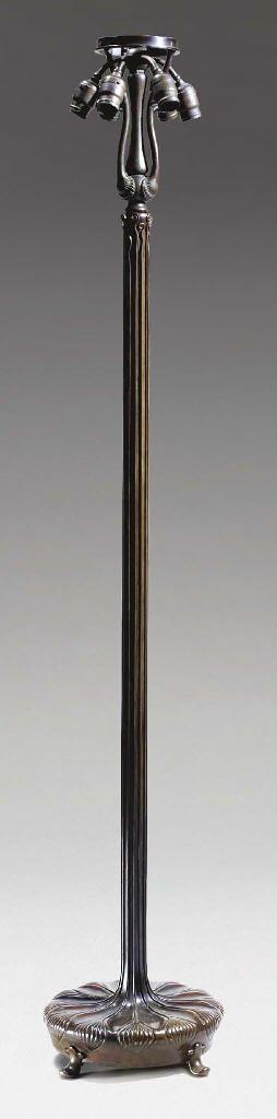 A BRONZE JUNIOR FLOOR LAMP BAS