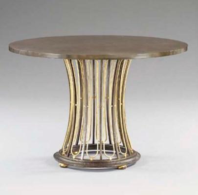 A PARCEL-GILT IRON TABLE