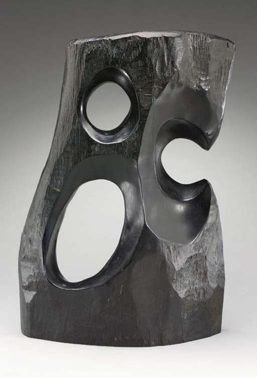 A CARVED EBONY SCULPTURE