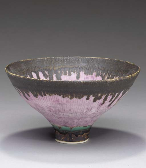 A FOOTED STONEWARE BOWL