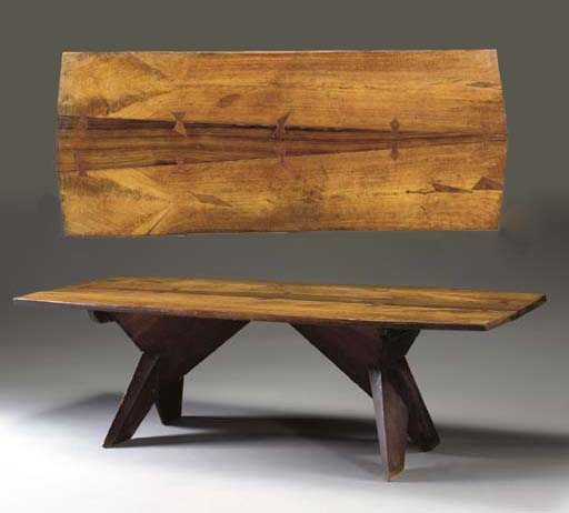 A CARVED WALNUT DINING TABLE