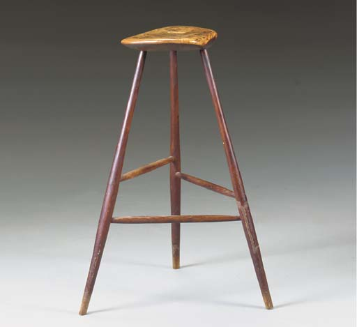 A WALNUT AND ASH STOOL