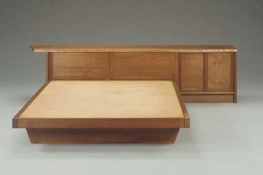 A WALNUT PLATFORM BED AND HEAD