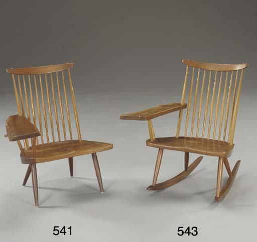 A WALNUT LOUNGE CHAIR WITH ONE