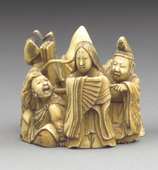 An Ivory Okimono and Two Ivory