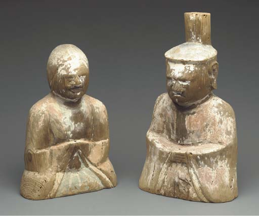 A Pair of Wood Sculptures of M