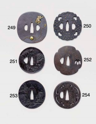 A Pierced Mokko Tsuba Attribut