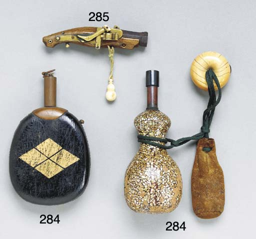 Two Powder Flasks and an Inlai