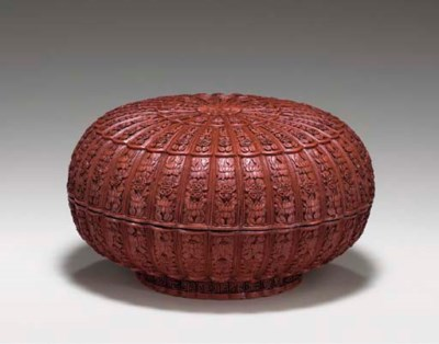 A CARVED RED LACQUER LOBED BOX