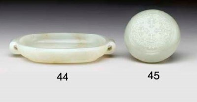 A SMALL WHITE JADE CUSHION-FOR
