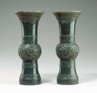 A PAIR OF FINELY CARVED GREEN