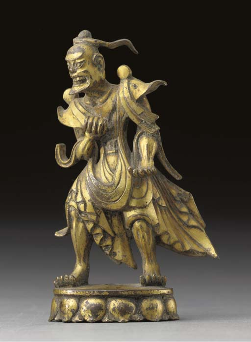 A RARE SMALL GILT-BRONZE GUARD