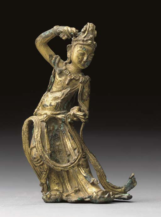A RARE GILT-BRONZE FIGURE OF A