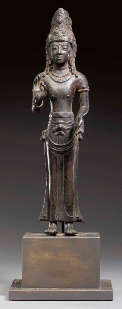 A RARE BRONZE FIGURE OF ACUOYE