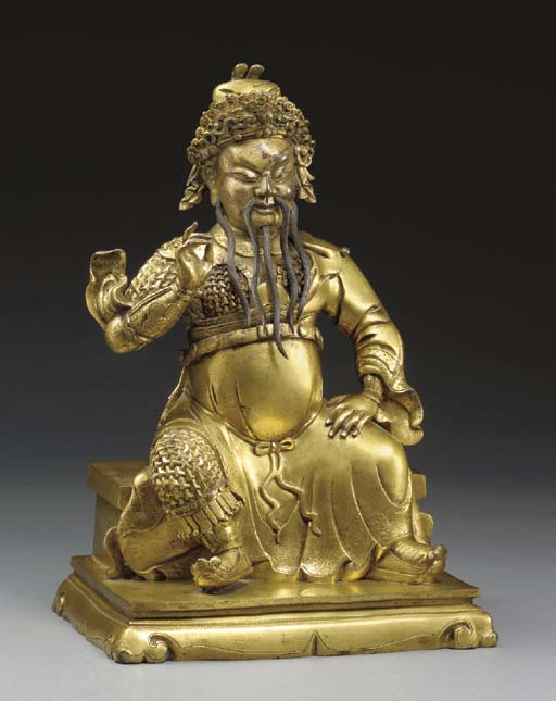 A GILT-BRONZE FIGURE OF GUANDI