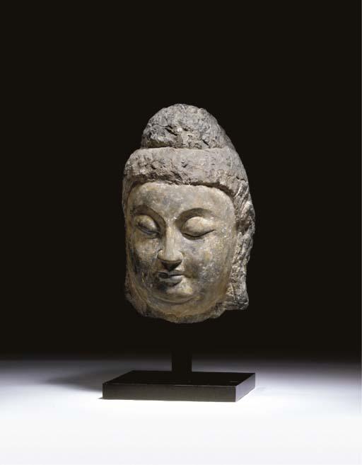 A GREY STONE HEAD OF BUDDHA