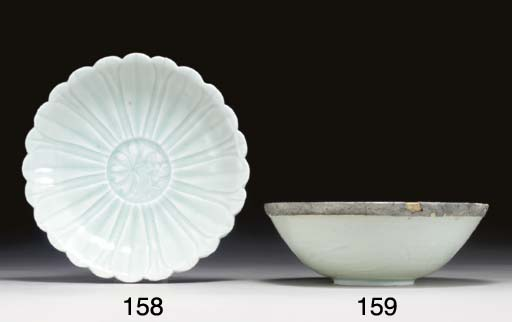 A QINGBAI CARVED BOWL WITH ORI