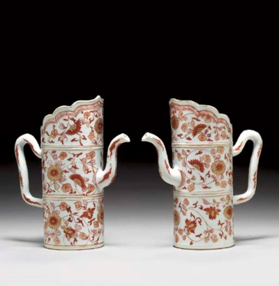 A PAIR OF SMALL IRON-RED AND G