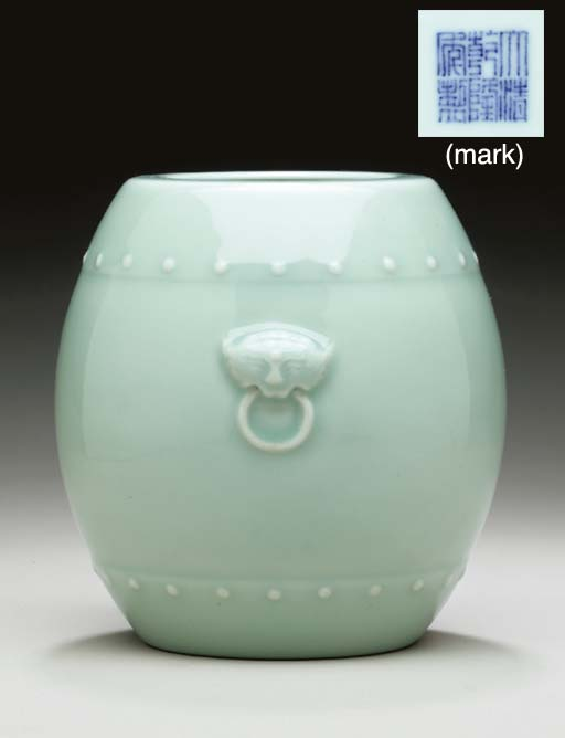A CELADON-GLAZED BARREL-SHAPED