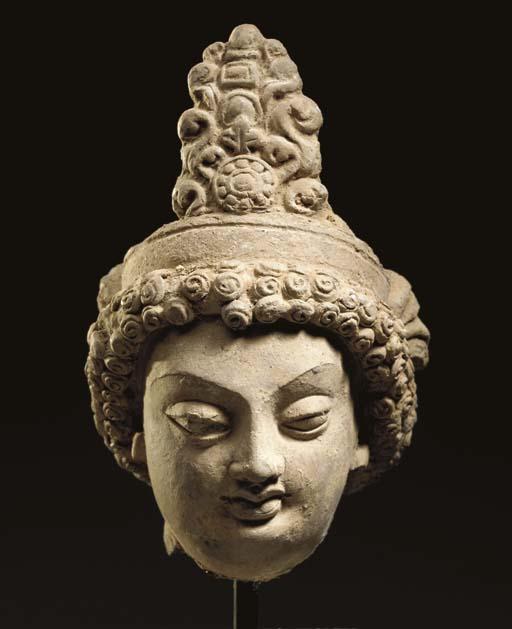 A Small Terracotta Head of a B