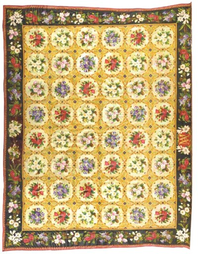 AN ENGLISH NEEDLEPOINT CARPET,