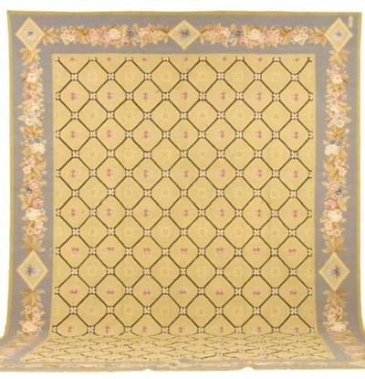 AN AUBUSSON STYLE CARPET,