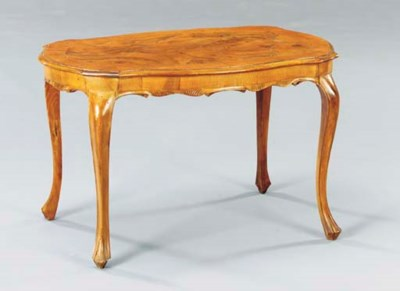 AN ITALIAN WALNUT LOW TABLE