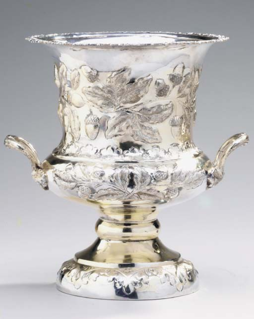 A SILVER-PLATED WINE COOLER,