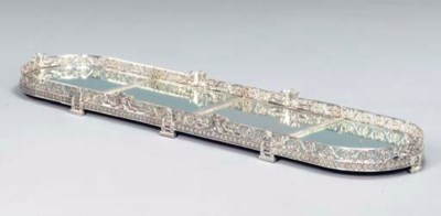 A SILVER-PLATED MIRROR PLATEAU