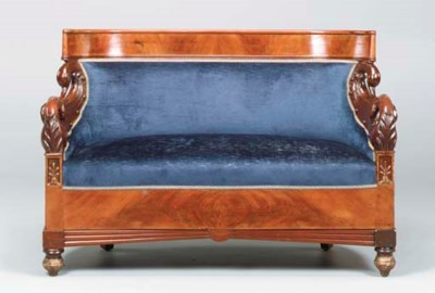 A BALTIC CARVED MAHOGANY AND P