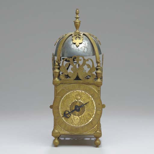 A SMALL BRASS LANTERN CLOCK WI