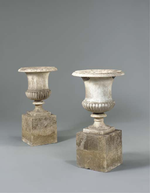 A PAIR OF REGENCY WHITE MARBLE