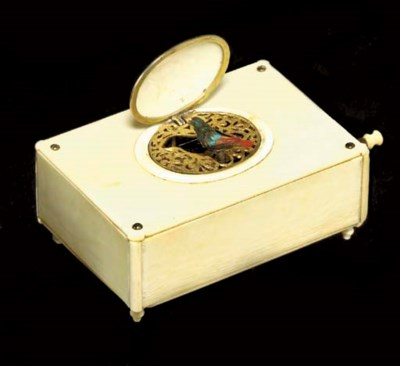 A FRENCH IVORY AND GILT-METAL